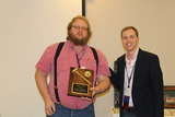 Harvey Petracek receives award from NAEBA ED
