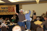 Auction team working hard to sell an elk to NY
